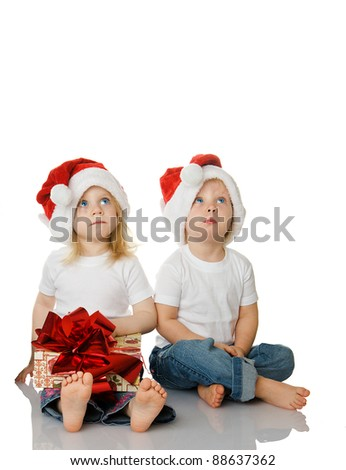 Two kids dreaming about christmas isolated on white background