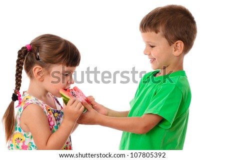 Two kids eating a watermelon, isolated on white