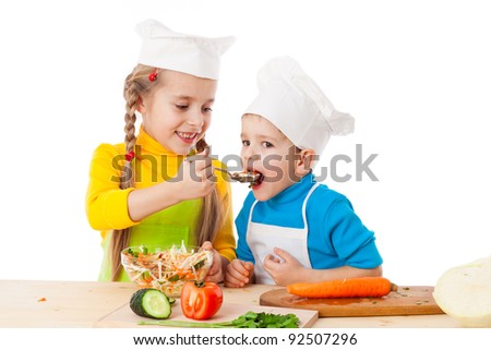 Two kids eating salad, isolated on white