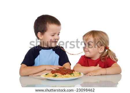 Two kids eating the same string of pasta - isolated