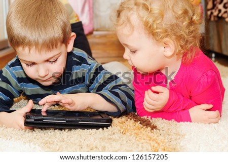 Two kids having fun with digital tablet