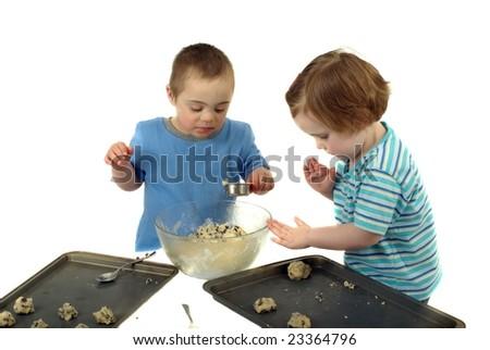 Two kids make chocolate chip cookies