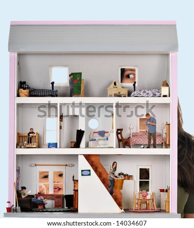Two kids peeking in a dollhouse where a real family of five is working and playing.