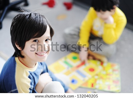 Two kids playing a game of cards