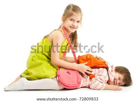 Two kids playing on the floor over a white background