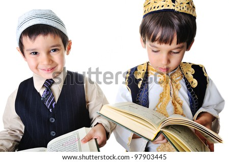 Two kids reading holy Quran - stock photo