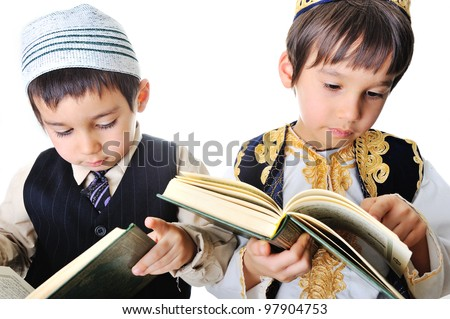 Two kids reading holy Quran