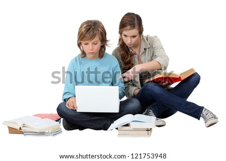 Two kids revising together