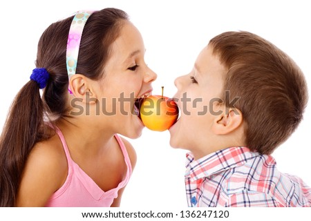 Two kids sharing the apple, isolated on white