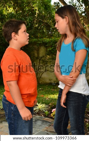 Two kids tallking/Siblings in Conversation/Two childern talking on path