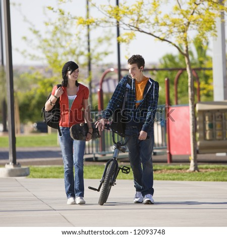 Two kids walk home