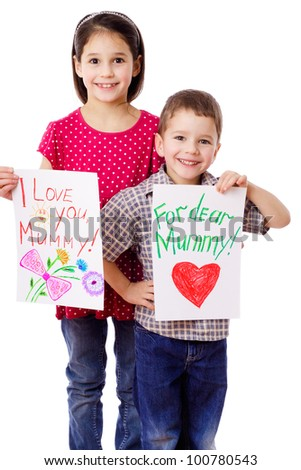 Two kids with greeting cards for mum, isolated on white