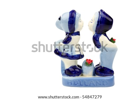 two kissing ceramic figurines from Holland on a white background
