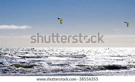 Two kite-surfers in action
