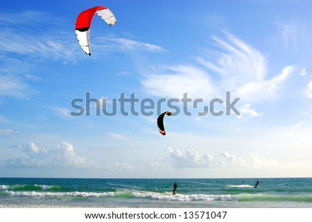 Two kitesurfers and a beautiful blue sky