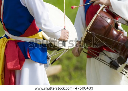 Two Korean drummers playing the traditional hourglass-shaped drum (janggu).