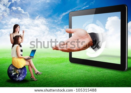 Two lady look at Tablet computer and the hand : Elements of this image furnished by NASA