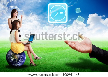 Two lady look at the Clock icon from business man on grass field : Elements of this image furnished by NASA