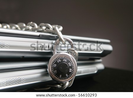 Two laptop computers with chain and a combination lock
