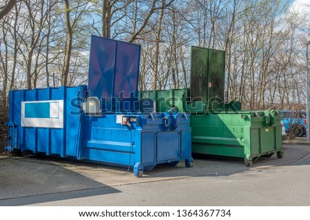 two large garbage compactors standing on a hospital site Foto stock ©