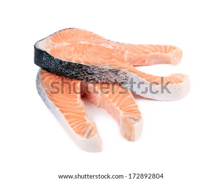 Two large pieces of raw salmon. Isolated on a white background.