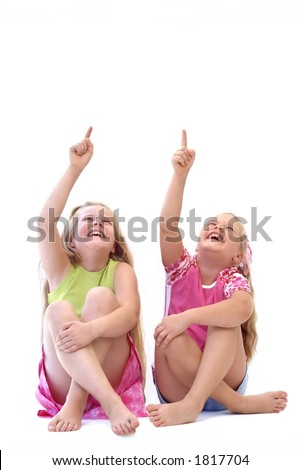 Two laughing girls, pointing towards.... your advertisement?