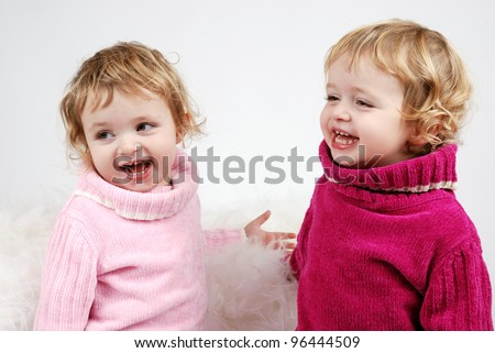 two laughing identical twin girls