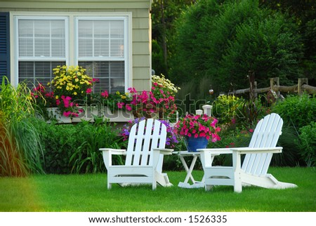 Two lawn chairs in a beautiful garden