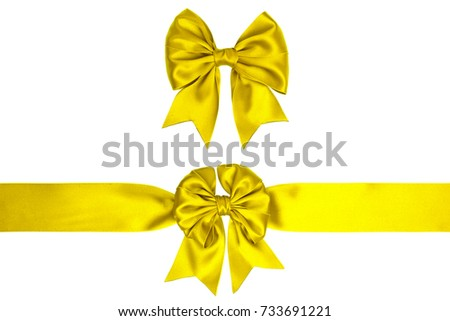 Two lemon yellow satin gift bow with ribbon isolated on white