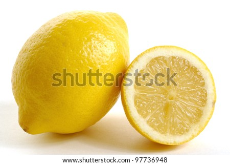 two lemons on white zone including one distinct