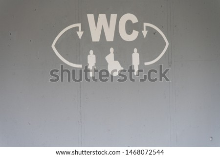 Two letters indicating the restrooms for women and men #1468072544