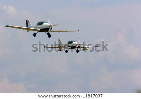 Two light aircrafts during a flight sport show ready for landing