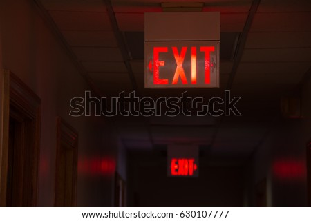 two lighted glowing red exit...