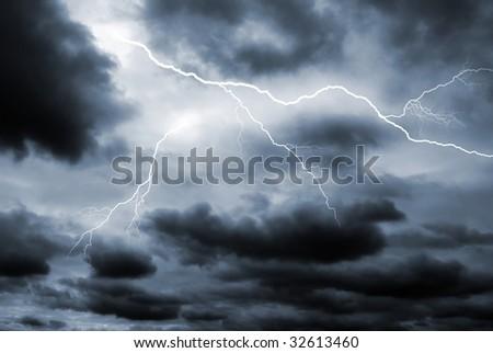 Two lightening bolts flash through a dark dramatic sky