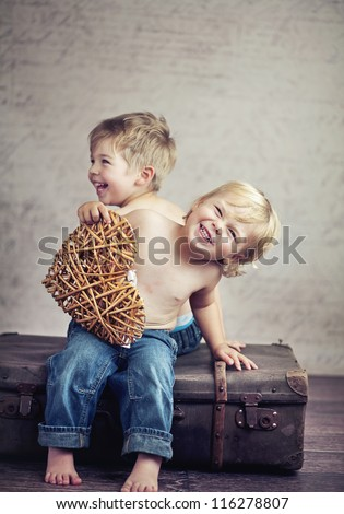 Two little boy brothers - stock photo