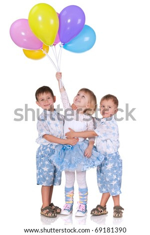 Two little boys cuddle a little girl holding a pile of balloons; isolated on the white background