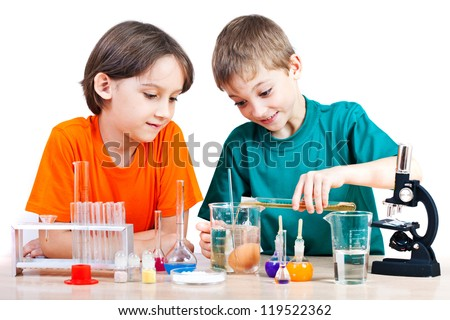 Two little boys doing biochemistry research at the lab Isolated on white