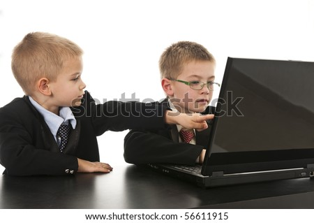 Two little boys dressed up in suits pretending to be businessmen. Isolated on white.