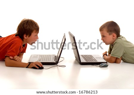 two little boys playing video games against each other