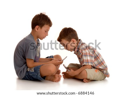 two little boys playing with mobile phones