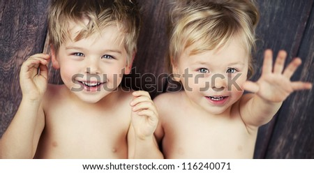 Two little boys smiling at the camera