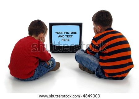 Two little boys watching commercial on TV