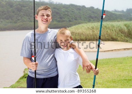 two little brothers fishing by the lake