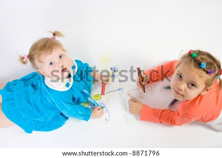 Two little caucasian girl painting