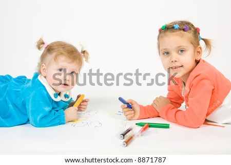 Two little caucasian girl painting . Isolate on white