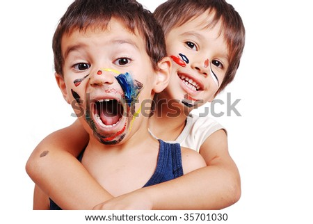 Two little cute brothers with colors on their faces