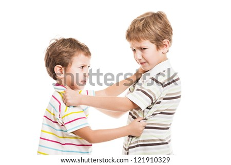 Two little displeased child boy brothers fighting in family conflict