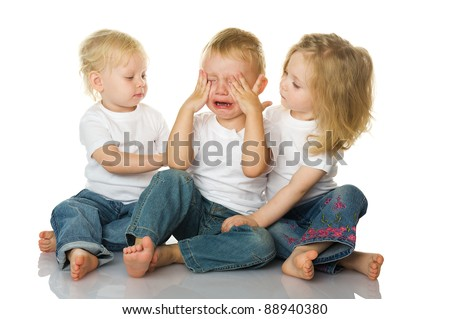 Two little girls calm the crying boy. isolated on the white background