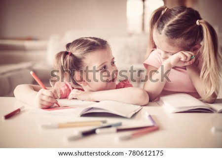 Two little girls drawing at home. Close up.  #780612175