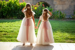 Two little girls dressed in first communion dresses